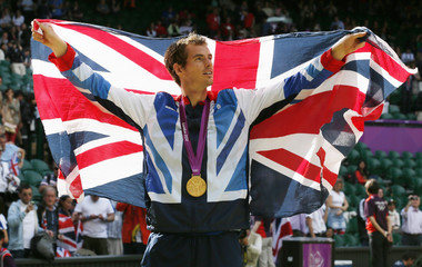 Gold medallist Murray of Britain celebrates during the presentation ceremony after winning the men's singles tennis gold medal match against Switzerland's Federer at the All England Lawn Tennis Club during the London 2012 Olympic Games