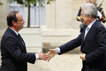France's President Hollande greets Italy's Prime Minister Monti before a working lunch at the Elysee Palace in Paris