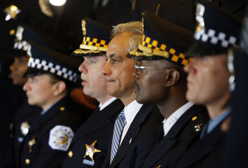Mayor of Chicago Emanuel sits beside Police Superintendent McCarthy during a group photo for Chicago Police Department's newest recruits in Chicago