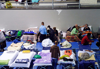 People are seen preparing to spend the night in a gym following an earthquake in Amatrice
