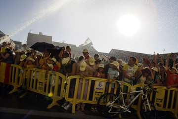 Fans of Contador are sprayed with water as they wait for the start of an official welcoming ceremony in Pinto