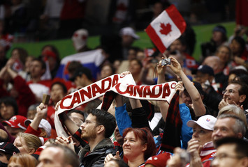 Canadian cheer on the Canadian women's hockey team during their game against Slovakia at the Vancouver 2010 Winter Olympics