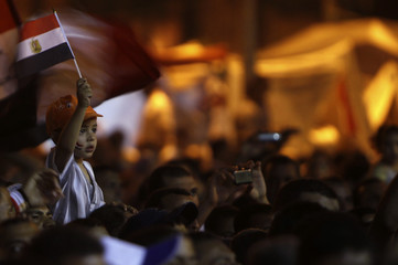 A boy is seen alongside other supporters of Egyptian President-elect Mursi during a sit-in demonstration in Cairo