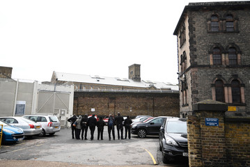 Prison guards stand outside Wandsworth Reform Prison as they take unofficial strike action to protest against staffing levels and health and safety issues, in London