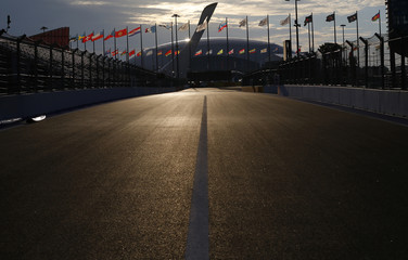 A general view of the Sochi Autodrom circuit with the Olympic flame cauldron and the Bolshoy Ice Dome in the background in Sochi