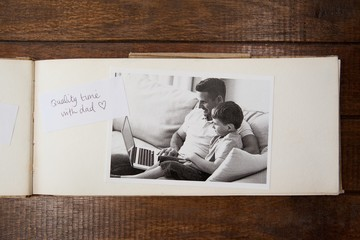Photo frame on wooden plank