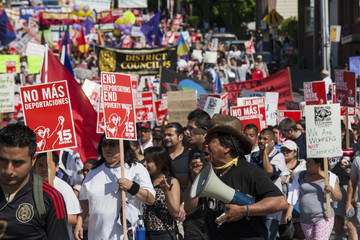 People march during Seattle's 14th annual May Day march for workers and immigrant rights