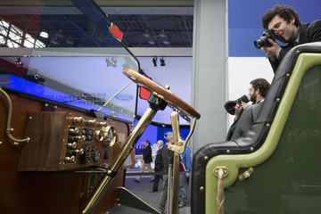A photographer takes pictures of the Creative Workshop prototype electric carriage at a media event at the Jacob Javits Convention Center during the New York International Auto Show