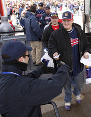 Indians fans enter stadium for the season opening MLB American League baseball game against White Sox in Cleveland