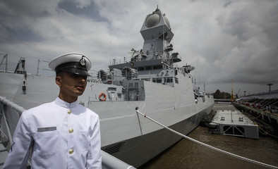 An Indian navy serviceman walks down the gangplank of the newly commissioned warship, INS Kolkata, during its commissioning ceremony at a naval base in Mumbai