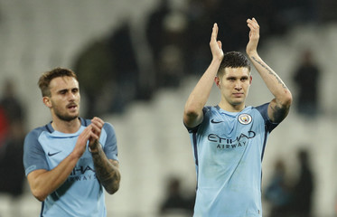 Manchester City's John Stones and Aleix Garcia Serrano applaud fans after the game