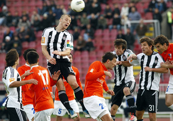 Partizan Belgrade's Ivan Ivanov jumps for the ball during game against Spartak during their Serbian Championship soccer match in Belgrade