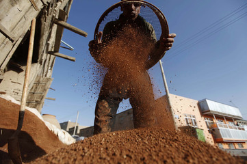 An Afghan man prepares to makes a tandoor oven used for making bread in Kabul