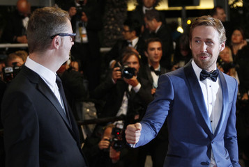 "Director Winding Refn and cast member Gosling pose during red carpet arrivals for the film ""Drive"", in competition at the 64th Cannes Film Festival"