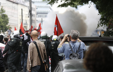 German riot police stops a demonstration against German government plans on budget cuts and taxes in Berlin