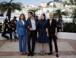 "Cast members Lea Seydoux, Gaspard Ulliel, Amira Casar and Aymeline Valade pose during a photocall for the film ""Saint Laurent"" in competition at the 67th Cannes Film Festival in Cannes"