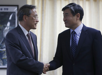 Junichi Ihara shakes hands with his South Korean counterpart Cho Tae-yong during their meeting at the Foreign Ministry in