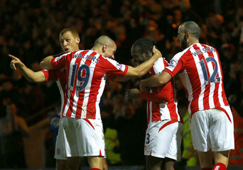 Stoke City's Moses celebrates after scoring a goal against Rochdale during their FA Cup fourth round soccer match at the Spotland stadium in Rochdale