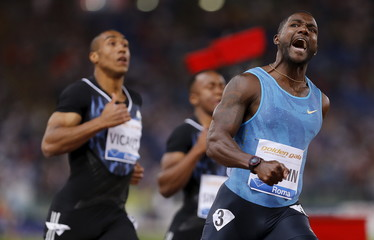 Gatlin from the U.S. reacts after winning the men's 100 meters event during the Golden Gala IAAF Diamond League at the Olympic stadium in Rome