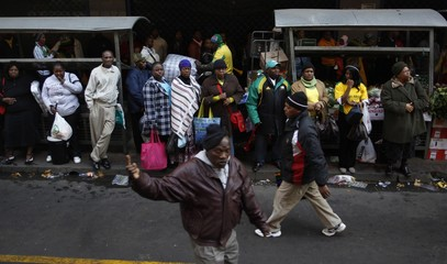 People are seen in a central street of Johannesburg
