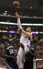 Los Angeles Clippers' Blake Griffin shoots as he is fouled by Memphis Grizzlies' Tony Allen near Zach Randolph defending during their NBA Western Conference basketball playoff game in Los Angeles
