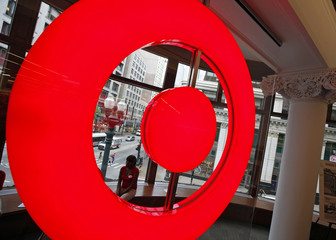 Employee at the new CityTarget store sits in a store window overlooking downtown Chicago, as they prepare for the opening