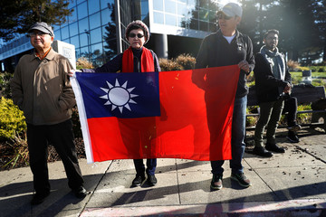 People hold a Taiwanese flag during President Tsai Ing-wen's visit during an stop-over after her visit to Latin America in Burlingame