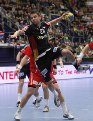 Sprenger of Germany attempts to score against Iceland during their main round match at Men's Handball World Championship in Jonkoping