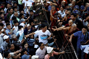 Protesters and police officers argue with each other as they protest in support of the two Myanmar migrant workers Zaw Lin and Win Zaw Htun in front of the Thai embassy in Yangon
