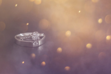 Diamond wedding ring on smoke background