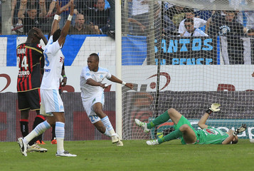 Olympique Marseille's Ayew reacts after scoring a goal against Nice's Ospina during their French Ligue 1 soccer match in Marseille