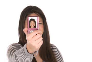 Teenager taking a self portrait