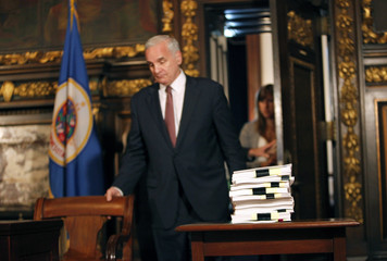 Minnesota Gov Mark Dayton prepares to sign bills to eliminate state budget deficit in St. Paul