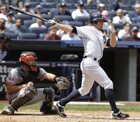 Yankees Gardner follows through on the swing of his three run triple against the Baltimore Orioles during the fourth inning of American League MLB baseball action at Yankee Stadium in New York