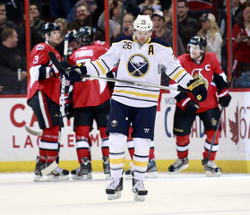 Sabres' Vanek skates away from Senators as they celebrate their third goal during the first period of their NHL hockey game in Ottawa