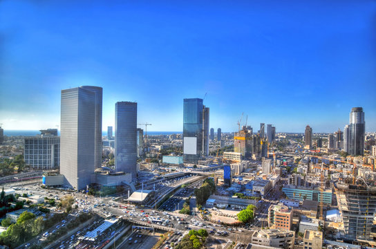 Colorful HDR image of the skyline of Tel Aviv with its skyscrapers on clear day of blue sky, Israel