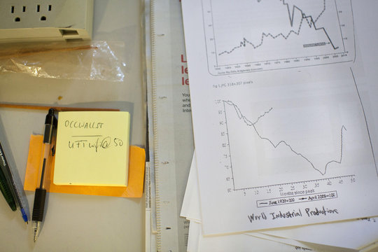 Papers and graphs are seen on a table in an office space being used by organizers of the Occupy Wall Street movement at 50 Broadway in New York