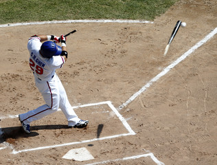 Taiwan's first baseman Chen Chun Hsiu breaks hit bat on a fly out at the first inning during a preliminary round baseball game against Hong Kong at the Munhak Baseball Stadium during the 17th Asian Games in Incheon