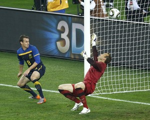 Australia's goalkeeper Schwarzer concedes a goal to Germany during the 2010 World Cup Group D soccer match at Moses Mabhida stadium in Durban