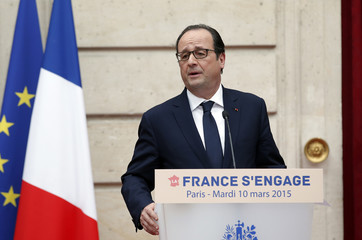 French President  Hollande delivers a speech to pay homage to the three French athletes were among the 10 people who died as two helicopters filming a reality show crashed in a remote part of Argentina on Monday, at the Elysee Palace