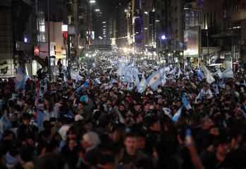 Argentina's fans celebrate their team winning the 2014 World Cup semi-finals against the Netherlands in Buenos Aires