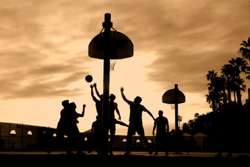 Basketball players at sunset
