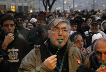 Thousands of protestors demonstrate against the Hungarian government in front of the parliament building in Budapest
