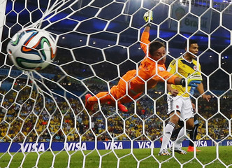 Uruguay's goalkeeper Muslera concedes a second goal scored by Colombia's Rodriguez during their 2014 World Cup round of 16 game at the Maracana stadium in Rio de Janeiro