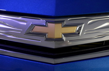 Chevrolet's logo is seen on a General Motors' 2016 Chevrolet Volt plug-in electric car at the LA Auto Show in Los Angeles