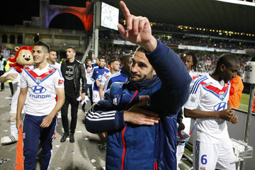 Olympique Lyon's Lisandro Lopez celebrates with team mates after they defeated Stade Rennais during their French Ligue 1 soccer match at the Gerland stadium in Lyon