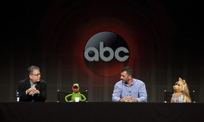 "Bill Prady, Bob Kushel, Kermit the Frog and Miss Piggy attend panel for Disney-ABC television series ""The Muppets"" during Television Critics Association Cable Summer Press Tour in Beverly Hills"
