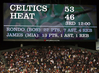 The score of the NBA Eastern Conference Finals basketball game between the Miami Heat and the Boston Celtics is shown on the scoreboard at Fenway Park in Boston