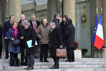 Major unions and employers' leaders leave following a meeting to work out a timetable for pension reform at the Elysee Palace in Paris