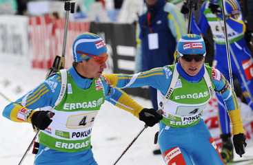 Semenov and Semerenko of Ukraine ski during the mixed 2 x 6 + 2 x 7.5 km relay Biathlon World Cup event in Pokljuka